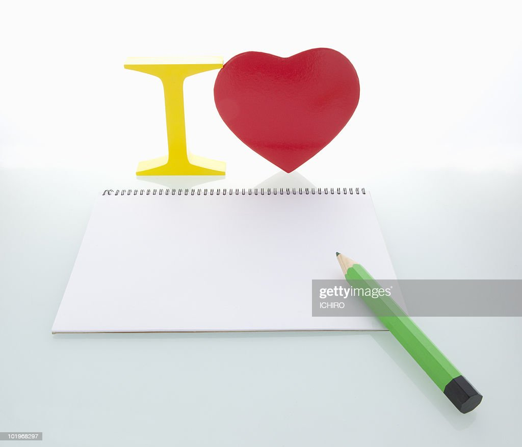 �?I�?sign and heart and sketchbook and pen : Stock Photo