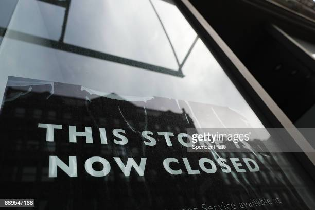 A sign announces the closing of a retail store in lower Manhattan on April 17 2017 in New York City As American's shopping habits continue to migrate...