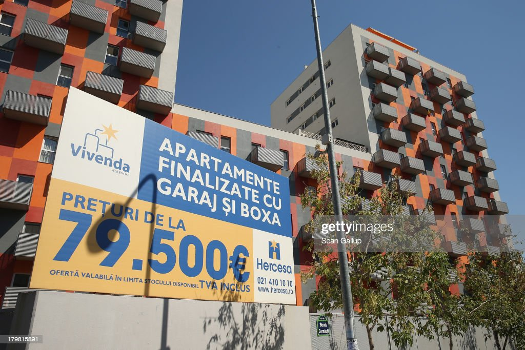 A sign announces the price of an apartment outside newly-built apartment buildings that are part of the Vivenda real estate development project on September 7, 2013 in Bucharest, Romania. While Romania's economic output has risen significantly since it joined the European Union in 2007, it still lags in infrastructure development and the fight against corruption.