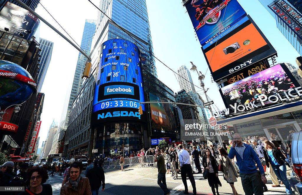 A sign announcing Facebook IPO is flashed on a screen outside the NASDAQ stock exchange after the opening bell in Times Square in New York, May 18, 2012. Facebook is set to go public on May 18, 2012 and is likely to have an estimated market valuation of over 100 billion USD when its shares begin trading on the NASDAQ. AFP PHOTO/Emmanuel Dunand