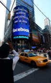 A sign announcing Facebook IPO is flashed on a screen outside the NASDAQ stock exchange after the opening bell in Times Square in New York May 18...