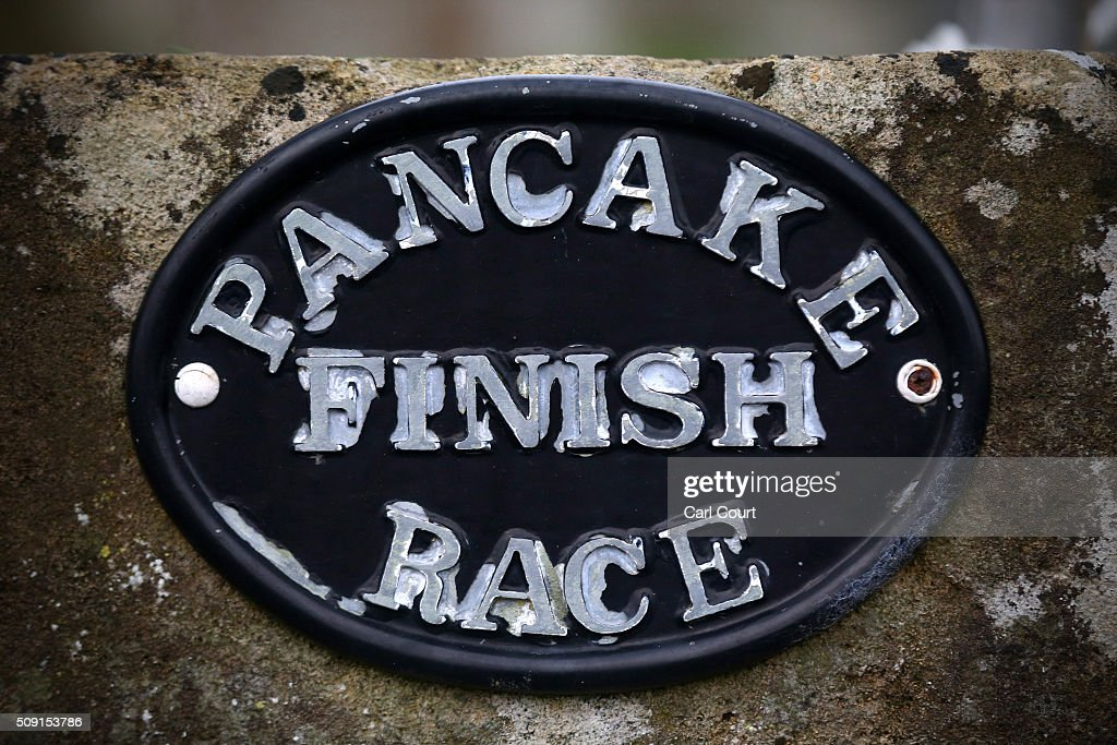 A sign announcing the pancake race finish line is pictured on February 9, 2016 in Olney, England. On Shrove Tuesday every year the ladies of Olney, Buckinghamshire compete in a Pancake Race, a tradition which dates back to 1445. Children from Olney schools also take part in their own races. Olney competes every year against the women of Liberal, Kansas, USA in a friendly race dating back to 1950.