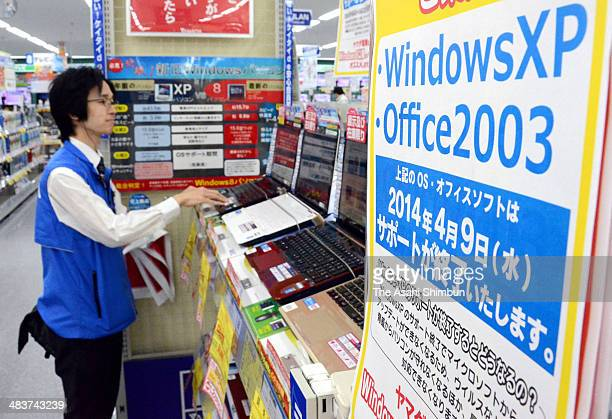 A sign announcing the support for Windows XP finish on April 9 is displayed at an electric store on April 9 2014 in Aomori Japan On April 9 Microsoft...
