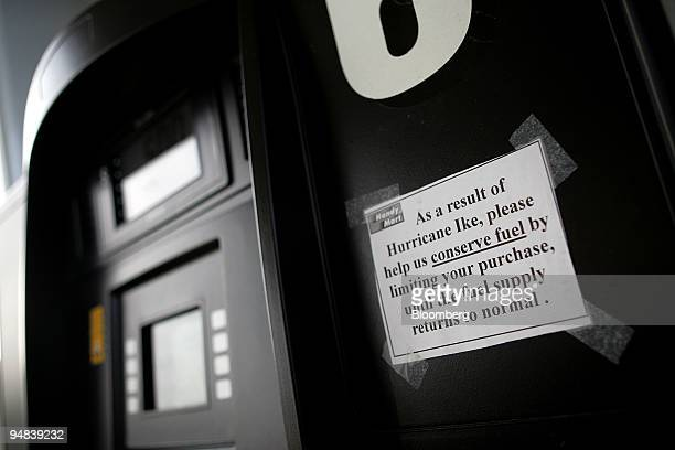 A sign asking patrons to limit their fuel purchase is taped to a pump at a Handy Mart gas station in Goldsboro North Carolina US on Thursday Oct 2...