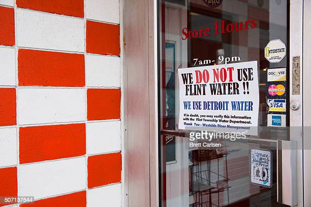 A sign at a local restaurant reassures customers that they are not on Flint water but on uncontaminated water pulled from Detroit on January 27 2016...