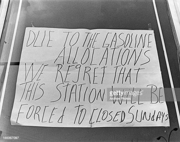 A sign at a petrol station announcing Sunday closures USA circa 1974 The sign reads 'Due to the gasoline allocations we regret that this station will...