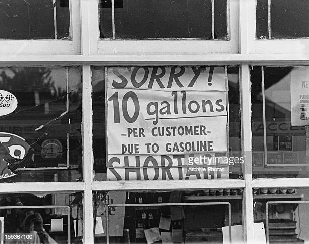 A sign at a petrol station announcing temporary fuel rationing USA circa 1974 The sign reads 'Sorry 10 gallons per customer due to Gasoline shortage'...
