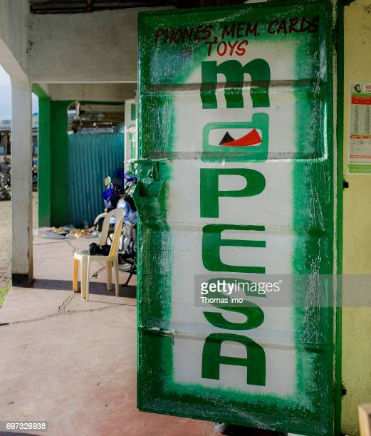 Sign at a shop of MPesa a system introduced by the mobile phone company Safaricom and Vodafone for cashless payment via mobile phone in Kenya on May...