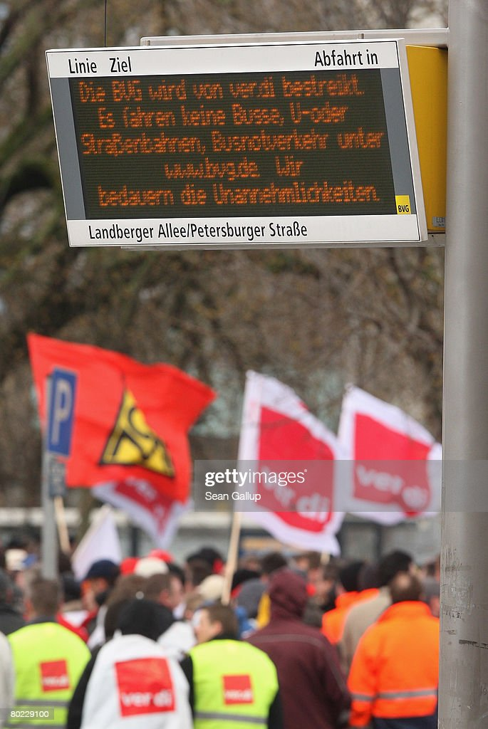 A sign at a tram stop informs travelers of a strike by workers of the Berlin public transit authority (BVG) as striking BVG workers protest nearby on the ninth day of their strike on March 13, 2008 in Berlin, Germany. The workers are represented through the ver.di service industries labour union, which is pushing for higher wages in negotiations that so far have made little headway. The strike hits Berlin public bus, tram and undergound train services.
