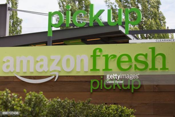 A sign at an AmazonFresh Pickup location is seen on June 16 2017 in Seattle Washington Amazon announced that it will buy Whole Foods Market Inc for...
