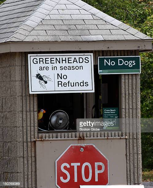 A sign at Crane Beach's entrance warns beach goers that greenhead flies are currently in season