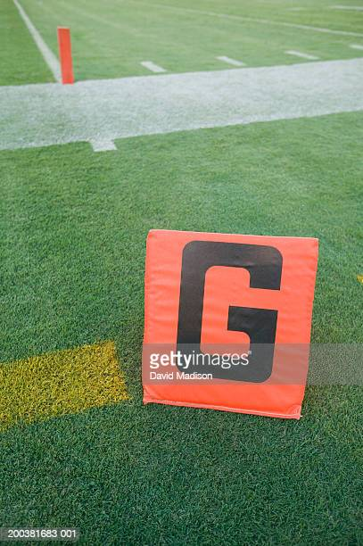 'G' sign at football goal line, elevated view