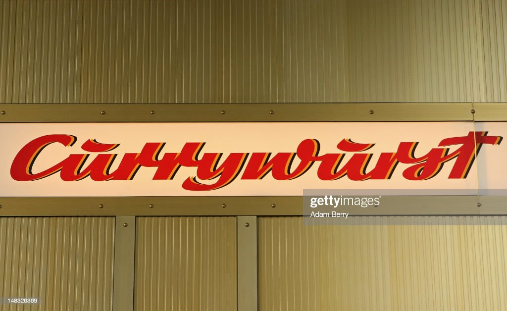 A sign at Konnopke's currywurst stand reads 'Currywurst' on July 14, 2012 in Berlin, Germany. Currywurst, originally founded in post-war Berlin by Herta Heuwa, is Berlin's answer to fast food and is sold at specialized stands across the city and the rest of Germany. Currywurst is pork sausage, with or without casing, fried or deep-fried, that is typically smothered in curry powder and a ketchup-like sauce called curry sauce and served with french fries.