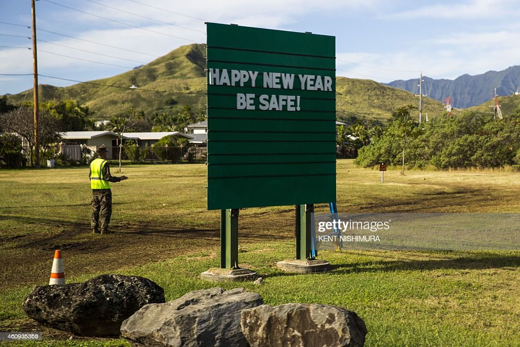 A sign at Marine Corps Base Hawaii wishing drivers a Happy New Year is seen as US President Barack Obama's motorcade departs Marine Corps Base Hawaii...