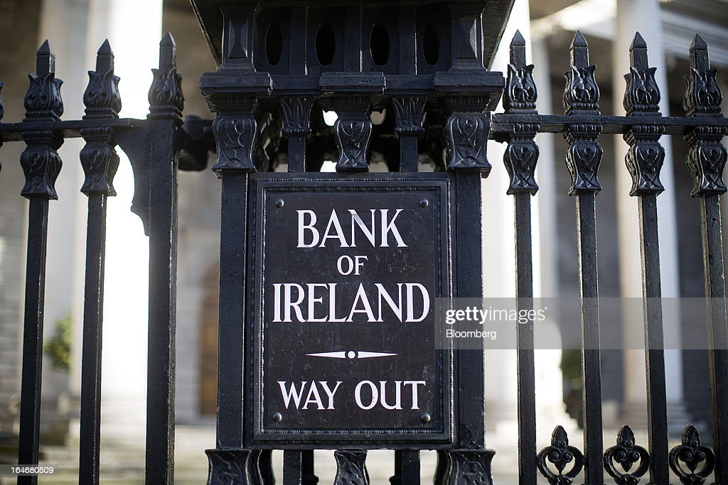 A sign at the Bank of Ireland Plc directing traffic reads 'Way Out' and is seen on the railings outside an entrance to the bank on Dame Street in Dublin, Ireland, on Saturday, March 16, 2013. Ireland's renewed competiveness makes it a beacon for the U.S. companies such as EBay, Google Inc. and Facebook Inc., which have expanded their operations in the country over the past two years. Photographer: Simon Dawson/Bloomberg via Getty Images