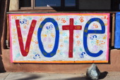 A sign at the Democratic Party's headquarters in Espanola New Mexico urges residents to vote a few days before the 2012 presidential election A...