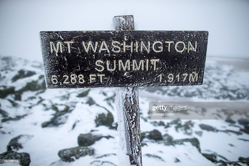 A sign at the summit of Mount Washington informs viewers that they are standing 6288 feet above sea level