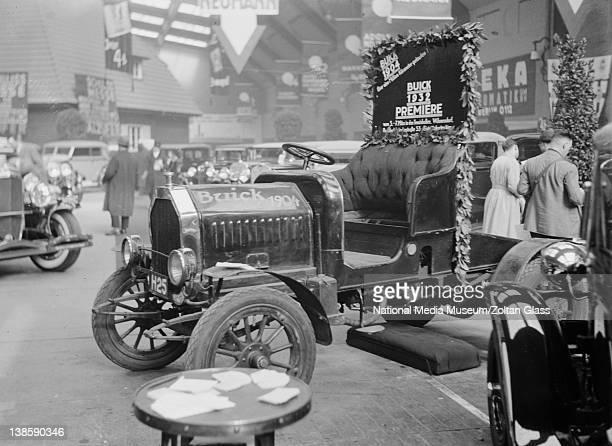 Sign behind car reads 'BUICK 1904 Uber eine Million Kilometer gelaufen' Photograph taken during Automobile Exhibition