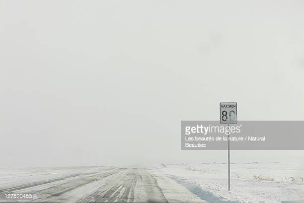 Sign board in snow road