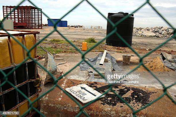 A sign board of Port City and wheelbarrow placed on ground in Chinese funding Colombo Port City Project site on October 15 2015 in Colombo Sri Lanka...