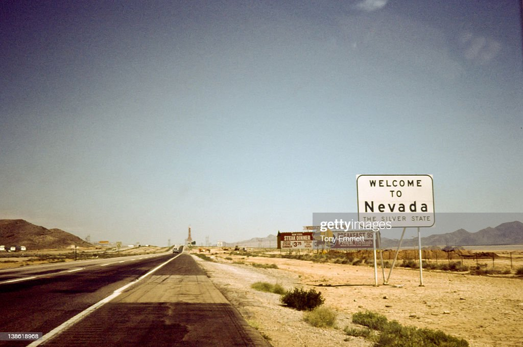 Sign board of 'welcome to Nevada' on road : Stock Photo