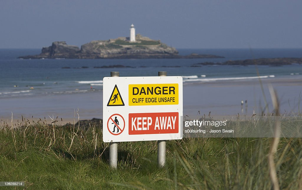 Sign board with godrevy lighthouse : Stock Photo