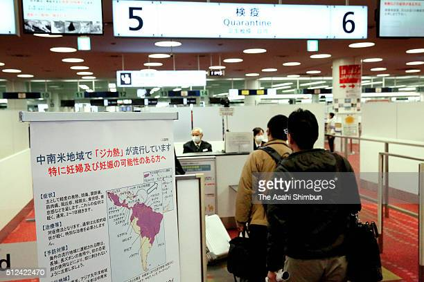 A sign calling for caution on the zika virus is displayed at the quarantine at the Haneda International Airport on February 26 2016 in Tokyo Japan...