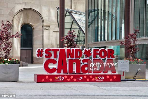 Sign celebrating the 150th birthday of Canada as preparations begin for the 150th anniversary of Canada in Toronto Ontario Canada Many celebrations...