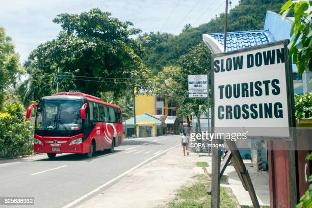 A sign close to Tanawan beach warns the passing drivers to slow down as a measure of protection towards the tourists going in and out of the resorts...