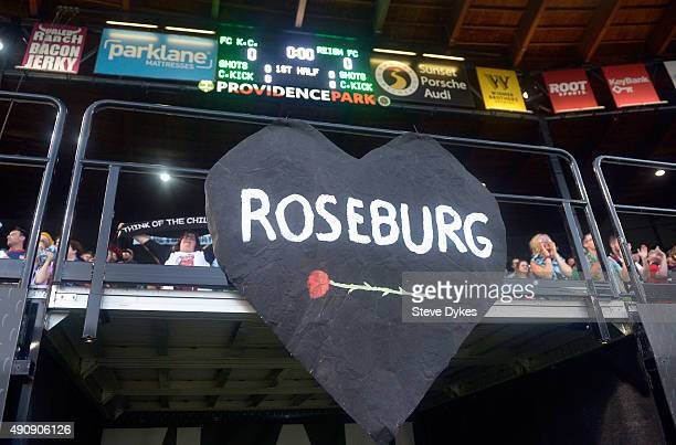 A sign commemorating the shootings in Roseburg Oregon hand in the stands during the game between the Seattle Reign FC and the FC Kansas City at...