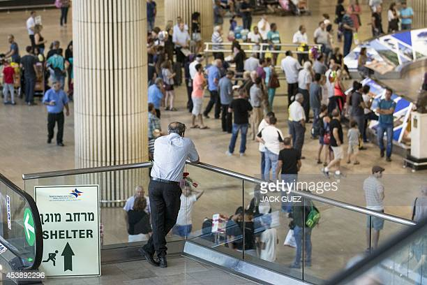 A sign directing passengers to a shelter is placed at Ben Gurion International airport near the Mediterranean Israeli coastal city of Tel Aviv on...