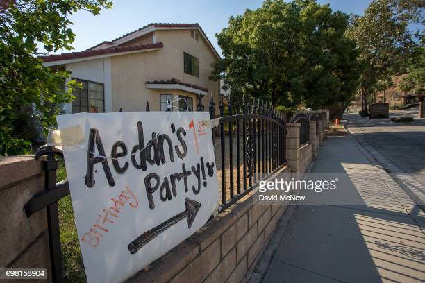 A sign directing people to a first birthday party points in the direction of the San Andreas Fault next to this house on June 18 2017 in Highland...