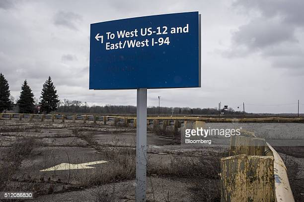 A sign direction to highways stands at the former site of the General Motors Co powertrain plant inside the Willow Run airport in Ypsilanti Michigan...
