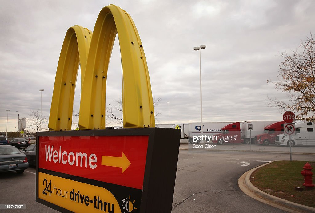 A sign directs customers to the drive-thru at a McDonald's restaurant on October 24, 2013 in Des Plaines, Illinois. McDonald's has announced it will make changes to its low-priced Dollar Menu, which includes items like coffee, small fries, hamburgers and apple pies. The new menu, dubbed the Dollar Menu and More, will offer some higher priced options such as the grilled Onion Cheddar Burger and a McChicken sandwich.