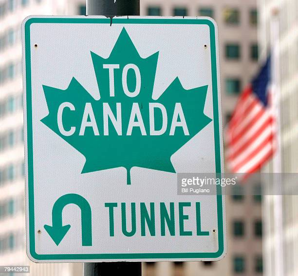 A sign directs drivers to the border crossing at the Detroit/Windsor Tunnel January 31 2008 in Detroit Michigan Today is the first day that new rules...