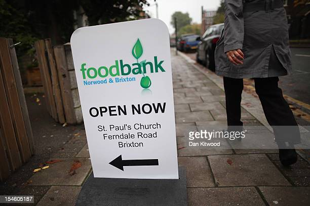 A sign directs to a Food Bank depot outside St Paul's Church in Brixton on October 23 2012 in London England The need for food banks has increased...