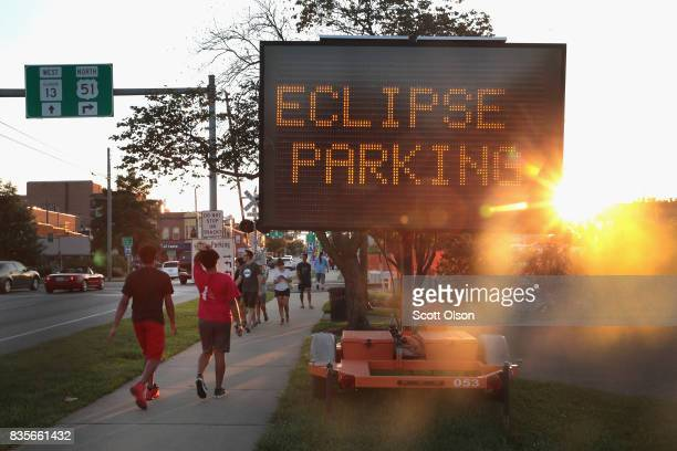 A sign directs visitors to parking areas to view the solar eclipse on August 19 2017 in Carbondale Illinois With approximately 2 minutes 40 seconds...