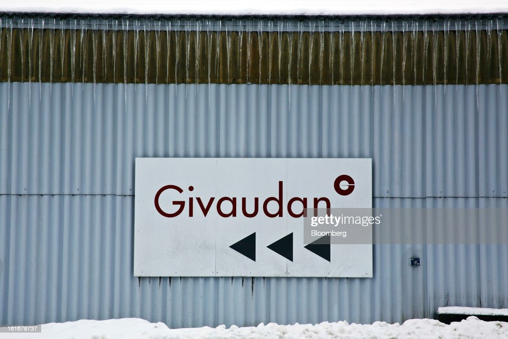 A sign directs visitors to the entrance of Givaudan SA's headquarters in Dubendorf, Switzerland, on Wednesday, Feb. 13, 2013. Givaudan SA, the world's largest maker of flavorings and fragrances, announced a bigger-than-estimated dividend after riding out a year of high raw-material prices and a strong Swiss franc. Photographer: Gianluca Colla/Bloomberg via Getty Images