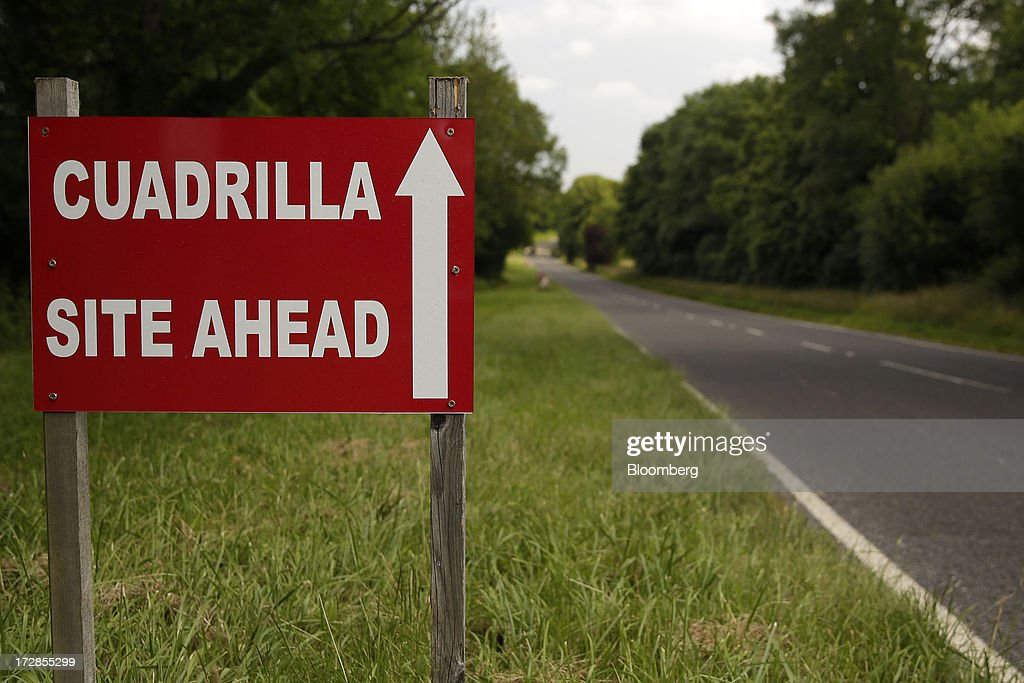 A sign directs visitors towards Cuadrilla Resources Ltd.'s exploratory shale gas drill site in Balcombe, West Sussex, U.K., on Friday, July, 5, 2013. Two areas of Surrey and Sussex hold 700 million barrels of recoverable shale oil, or more than a year's supply for Britain, the U.S. Energy Information Administration estimates. Photographer: Matthew Lloyd/Bloomberg via Getty Images