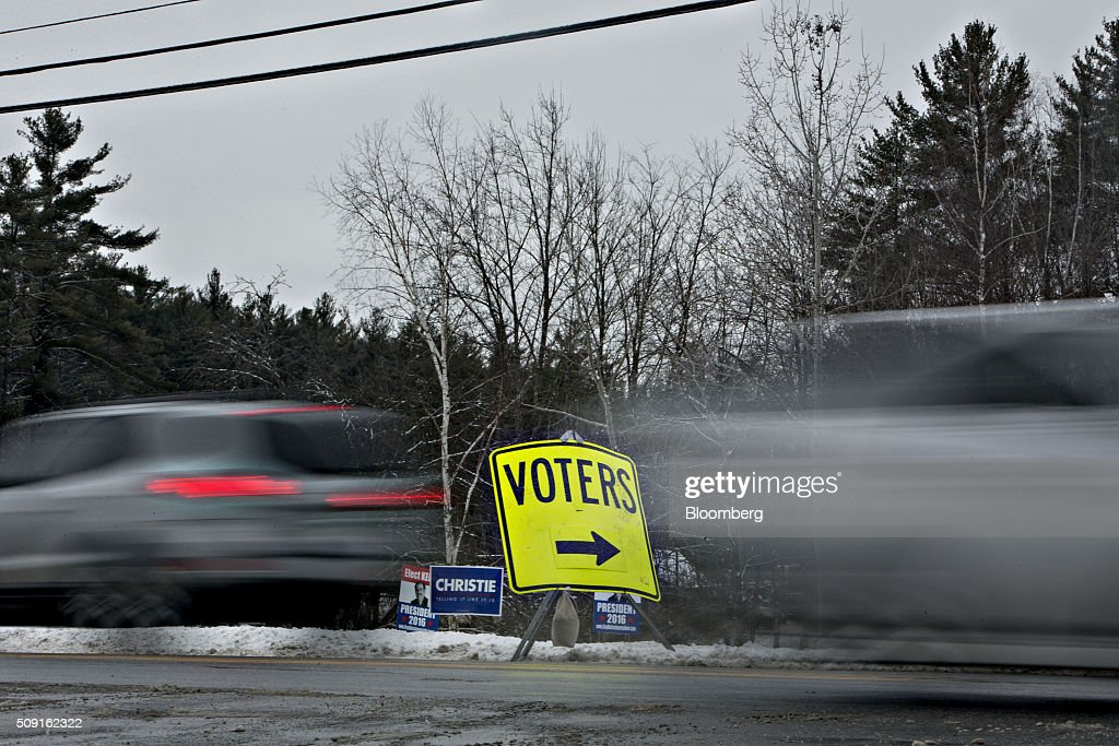A sign directs voters toward a polling station in Bedford, New Hampshire, U.S., on Tuesday, Feb. 9, 2016. Voters in New Hampshire took to the polls today in the nations first primary in the U.S. presidential race. Photographer: Daniel Acker/Bloomberg via Getty Images