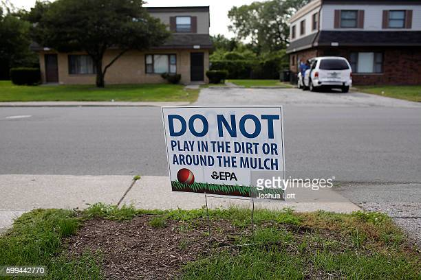 A sign displayed in a front yard request that residents keep fro playing in the dirt or mulch at the West Calumet Housing Complex on September 4 2016...
