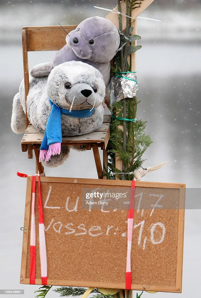 A sign displaying air and water temperatures hangs next to the cold waters of Orankesee lake during the 'Winter Swimming in Berlin' event on January 12, 2013 in Berlin, Germany. A local swimmers' group called the 'Berlin Seals' invite ice swimmers from across Germany and abroad to the annual event, which, despite warmer temperatures this winter and a lack of ice, was still held. Members claim ice swimming is good for the body's blood circulation.