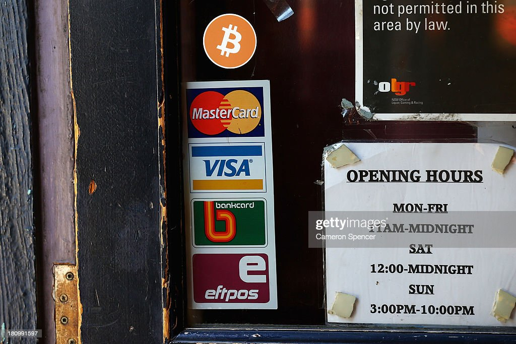 A sign displaying Bitcoins accepted is seen on the front door of the Old Fitzroy Pub on September 19, 2013 in Sydney, Australia. The Old Fitzroy pub in Sydney's eastern suburbs will accept the digital currency, Bitcoin, as of Next Sunday. Using a smartphone and a QR code scanning application customers will be able to purchase beer and menu items at the bar. The Old Fitzroy is the first Australian pub to accept Bitcoin payment.