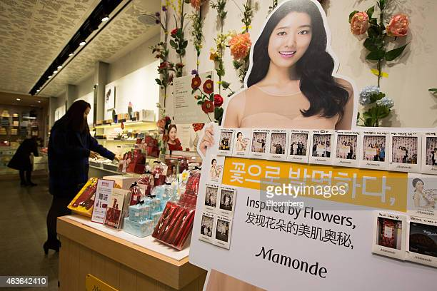 A sign displaying Korean English and Chinese wording stands inside an Amorepacific Corp Mamonde store in the Myeongdong shopping district in Seoul...