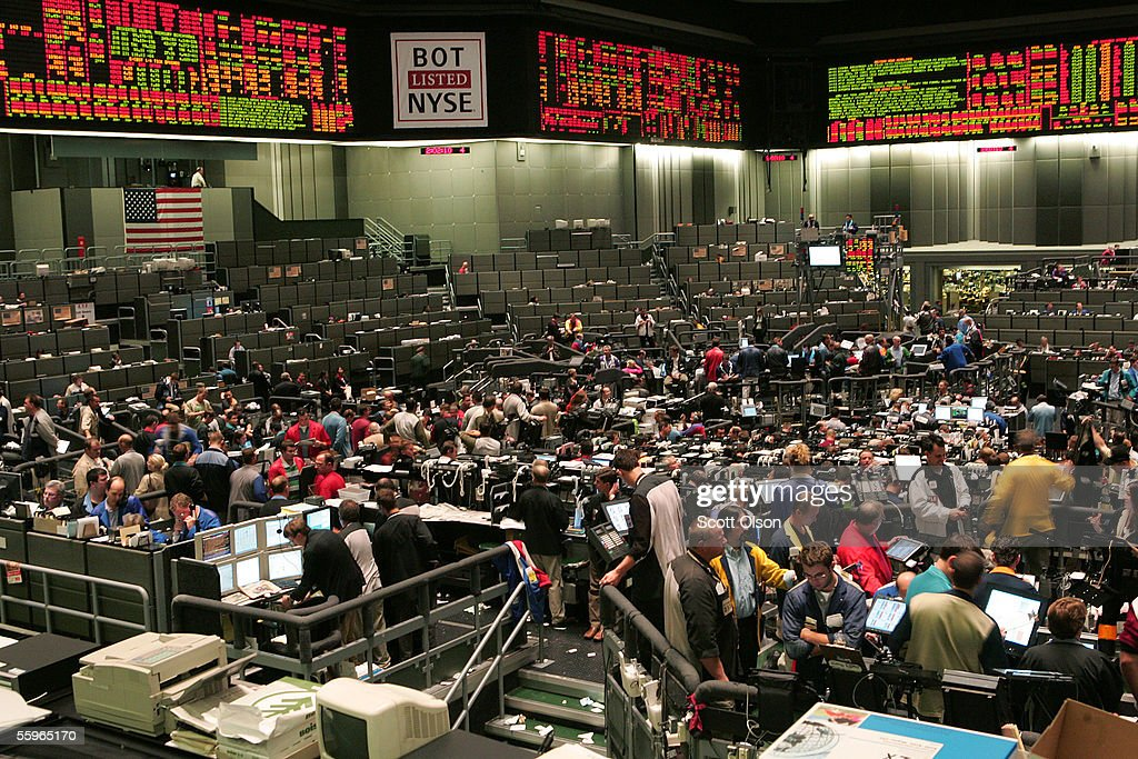 A sign displaying the new ticker symbol, BOT, hangs over the trading floor at the Chicago Board of Trade (CBOT) October 19, 2005 in Chicago, Illinois. The CBOT watched its initial public offering shoot up over 50 percent today after the launch of its initial public offering this morning on the New York Stock Exchange.