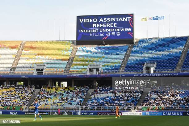 A sign displays an incident is being reviewed by officials during the U20 World Cup quarterfinal football match between Italy and Zambia in Suwon on...