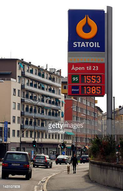 A sign displays the price in kroner of unleaded and diesel fuels outside a gas station operated by Statoil Fuel Retail ASA situated in front of the...