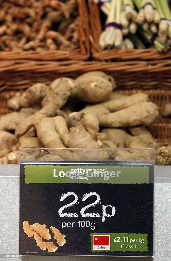 A sign displays the price in pounds of loose stem ginger, imported from China in the fruit and vegetable section of a Morrisons supermarket, operated by William Morrisons Supermarkets Plc, in Chadderton, U.K., on Monday, Dec. 17, 2012. The British Christmas is the biggest epicurean occasion of the year, with households spending a total of 4 billion pounds on food in the final week before Dec. 25. Photographer: Paul Thomas/Bloomberg via Getty Images