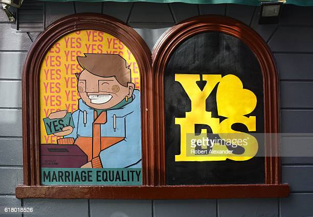 A sign encouraging Irish voters to approve a referendum legalizing samesex marriage remains on display in Dublin Ireland a year after voters approved...