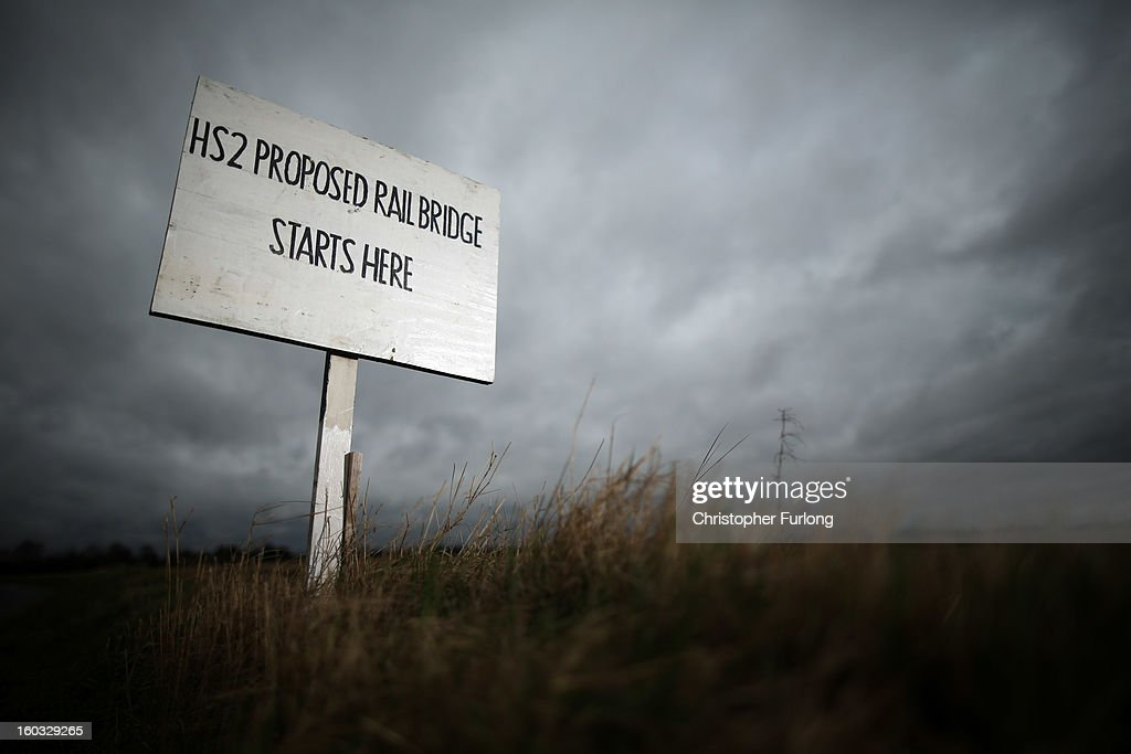 A sign erected by protesters marks the spot where a new rail bridge is proposed to be built across the countryside for the new HS2 high speed train link at the village of Middleton in Staffordshire on January 29, 2013 in Middleton near Tamworth, England. The government yesterday released details of the next phase of the GBP 32 billion HS2 high-speed rail network, which will link Manchester and Leeds.